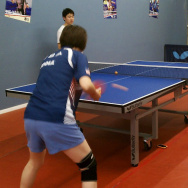 Erica Wu practices table tennis with an opponent