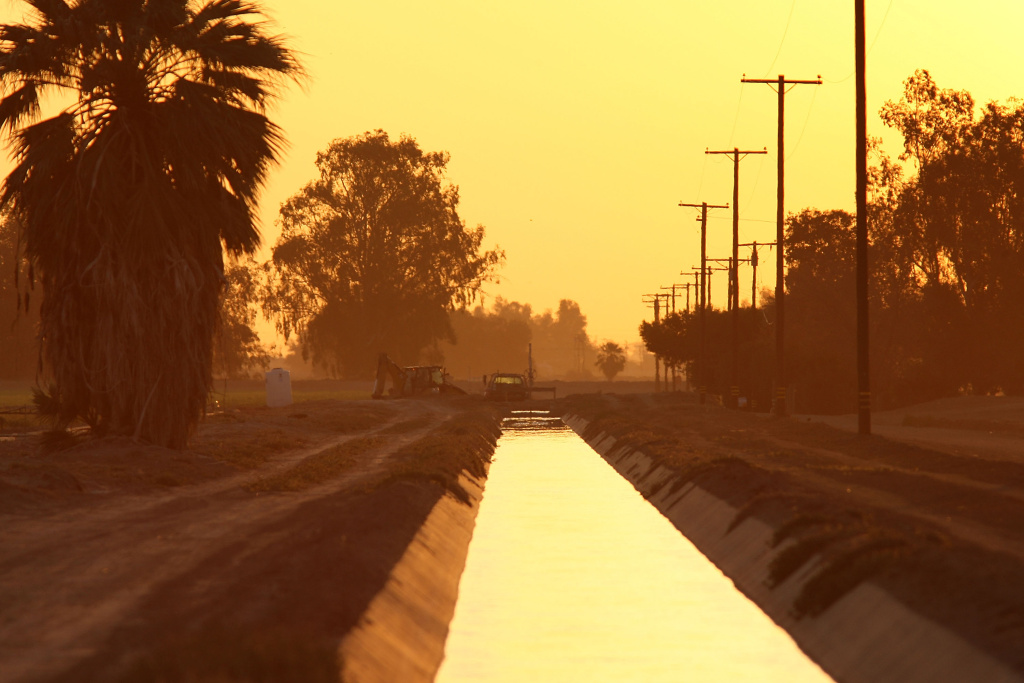 EL CENTRO, CA - MARCH 12:  A farm canal is illuminated by the sunrise March 12, 2009 near El Centro, California. El Centro is suffering the highest unemployment rate in the nation at 22.6 percent, nearly as high as rates during the Great Depression, with Latinos especially being hit hard. The people of the Imperial Valley, an important food producing region in the desert north of the U.S.-Mexico border and east of San Diego, are plagued with a devastating combination of drought, which has farmers desperate for water; a construction-idling housing bust; and a plummeting peso, which undercuts the buying power of Mexicans who shop on the U.S. side of the border. On top of that, California is reeling from a massive budget crisis that ushered in higher taxes and deep cuts to programs and services statewide.