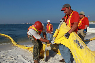 Workers assemble an oil containment boom in an attempt to protect the inlet waterways from the Deepwater Horizon oil spill in the Gulf of Mexico on June 7, 2010 in Pensacola, Florida.