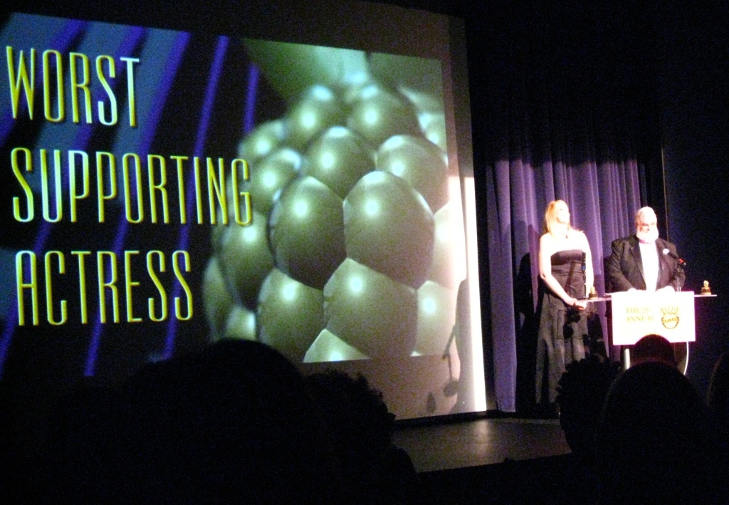 Hosts award the trophy for Worst Supporting Actress at the 2009 Razzie Awards.