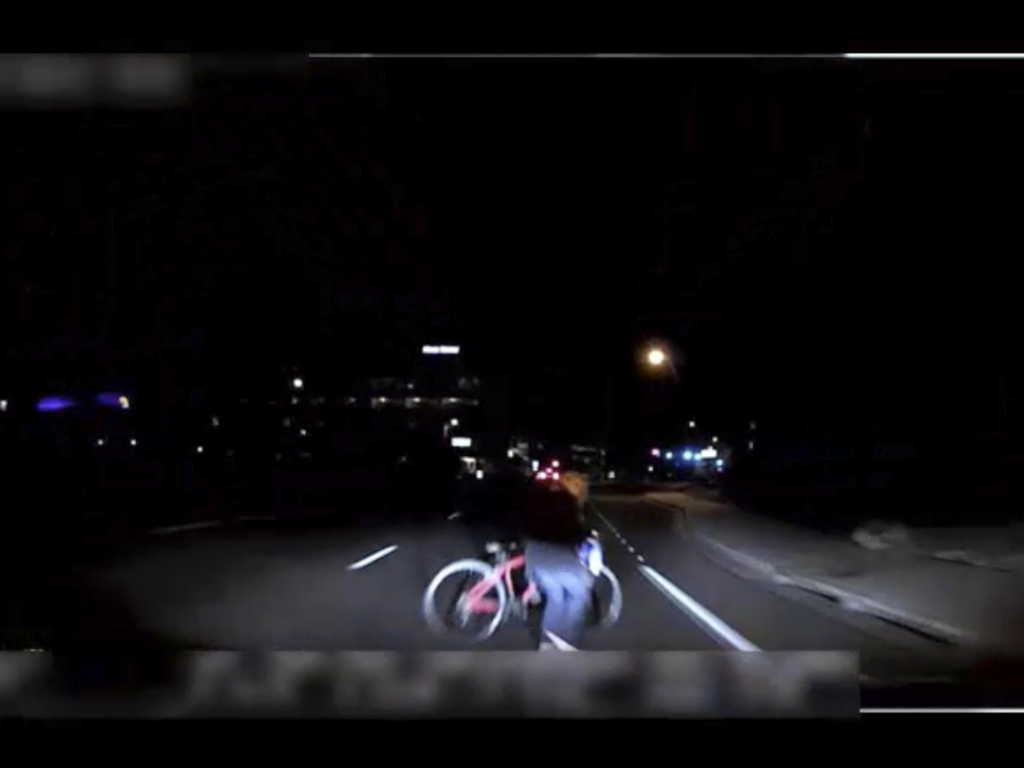 This image made from video of a mounted camera provided by the Tempe Police Department shows an exterior view moments before an Uber SUV hit a woman on Sunday in Tempe, Ariz.