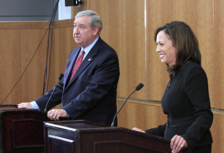 San Francisco District Attorney, Kamala Harris, right, the Democratic candidate for Attorney General, laughs at a light-hearted comment made by her opponent, Los Angeles County District Attorney Steve Cooley, left, during their debate at the University of California, Davis, School of Law in Davis, Calif., Tuesday, Oct. 5, 2010.