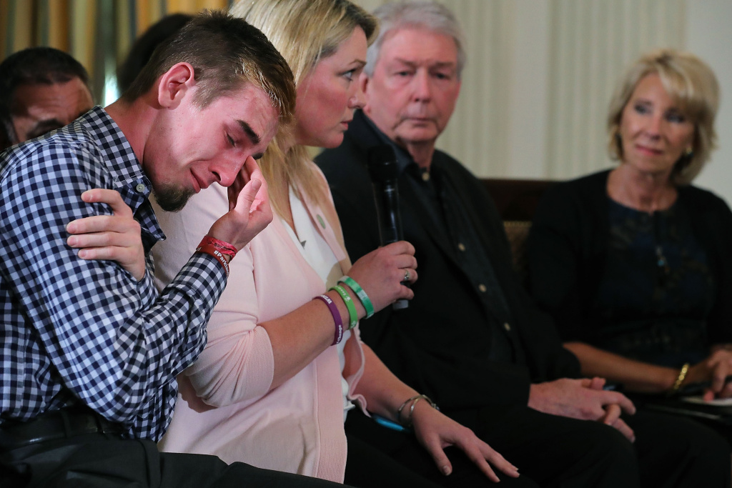 Marjory Stoneman Douglas High School senior Samuel Zeif weeps after talking about how his best friend was killed during last week's mass shooting while he participates in a listening session hosted by U.S. President Donald Trump on February 21, 2018 in Washington, DC.