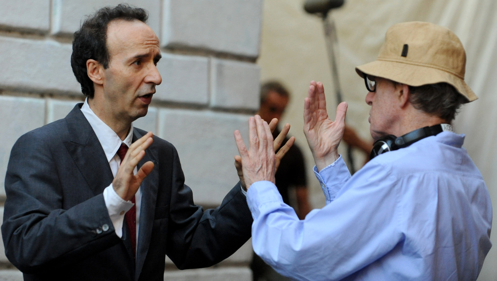 Woody Allen speaks to Italian actor-director Roberto Benigni on the set of 'Bop Decameron' at St.Maria in Trastevere square in central Rome, on August 8, 2011.