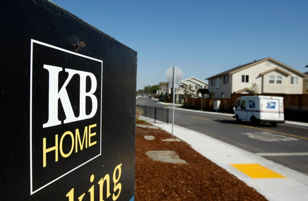 A sign is seen outside of a KB Home sales center in California. The Commerce Department Wednesday said U.S. homebuilders began work at a slower pace in January, though the level was still the third-highest since 2008. The pace of building was viewed as a sign of further strengthening in residential real estate.