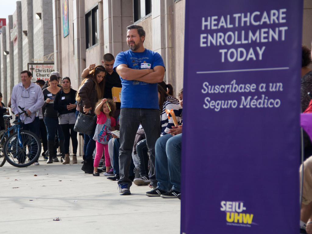 People wait to enter an Affordable Care Act enrollment event sponsored by SEIU-United Healthcare Workers West and Community Coalition in Los Angeles.