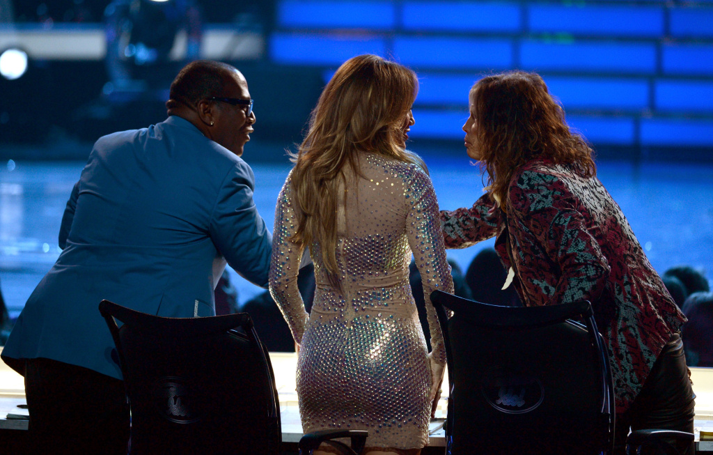 LOS ANGELES, CA - MAY 23:  Judges Randy Jackson, Jennifer Lopez, and Steven Tyler cheer onstage during Fox's