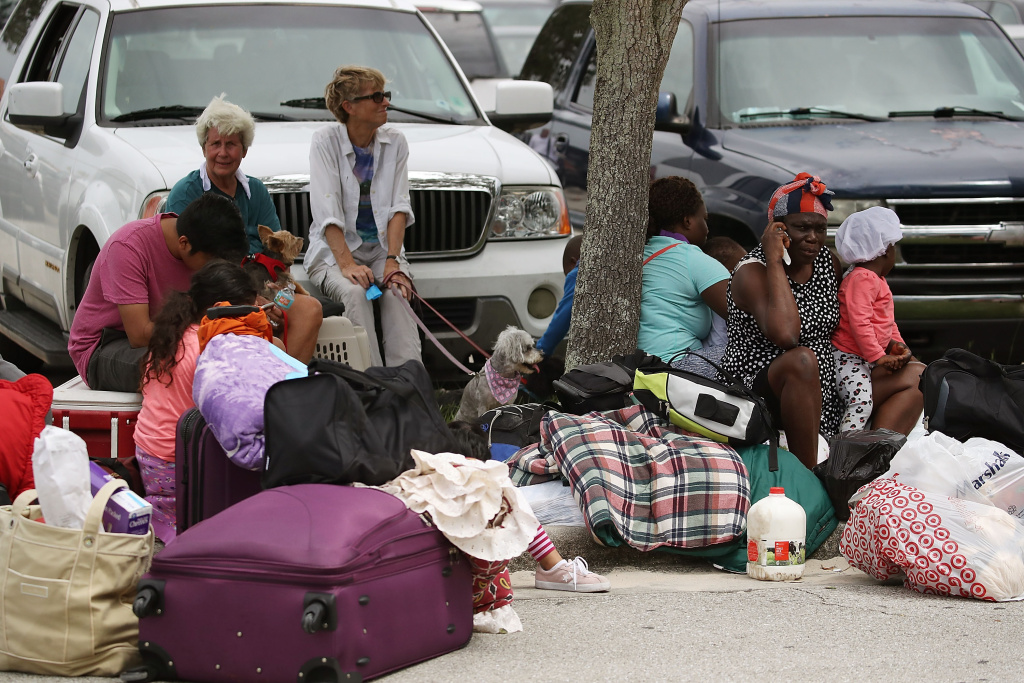 Evacuees wait to enter the Germain Arena in Estero, Florida on September 9, 2017 as Hurricane Irma approaches.