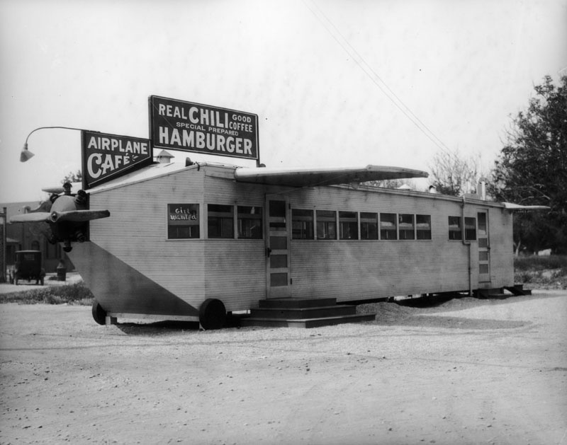 Although the exact L.A. location of The Airplane Café is unknown, the airplane-shaped restaurant came with wings, a propeller and wheels, although it rested on raised slabs of wood. (circa 1924) (Photo via Los Angeles Public Library Collection)