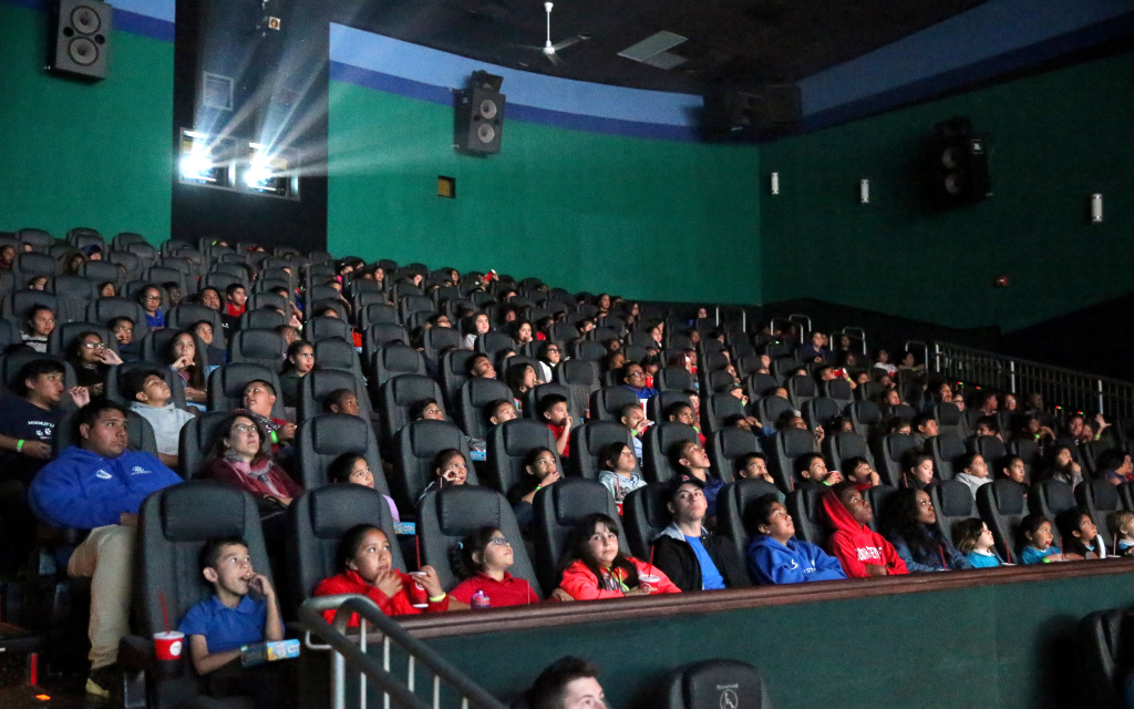Boys & Girls Club Long Beach members watch an advance IMAX screening of