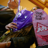 Code Pink activists deliver flowers, candies and other objects of thanks to Sen. Rand Paul's Capitol Hill offices Thursday for filibustering John Brennan's CIA nomination.