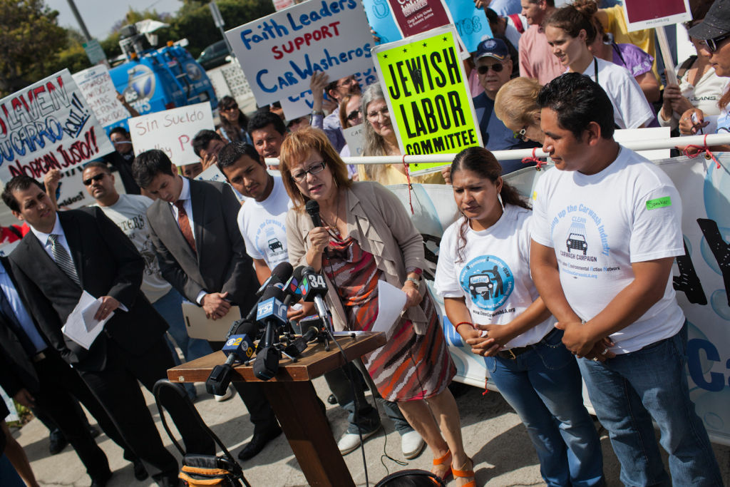 Maria Elena Durazo, seen here at a rally at the Santa Monica Car Wash, told Town Hall Los Angeles her mission is to bring full-time workers out of poverty and into the middle class.