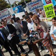 Maria Elena Durazo, executive secretary-treasurer of the Los Angeles County Federation of Labor, addressed the crowd at Santa Monica Car Wash where union officials and community leaders rallied Monday, May 21.