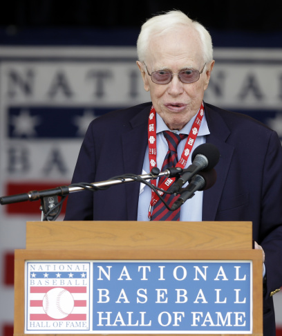 "Dr. Frank Jobe, known for the development of the historic elbow procedure known as ""Tommy John Surgery,"" speaks as he is honored during a ceremony at Doubleday Field on Saturday, July 27, 2013, in Cooperstown, N.Y. (AP Photo/Mike Groll)"