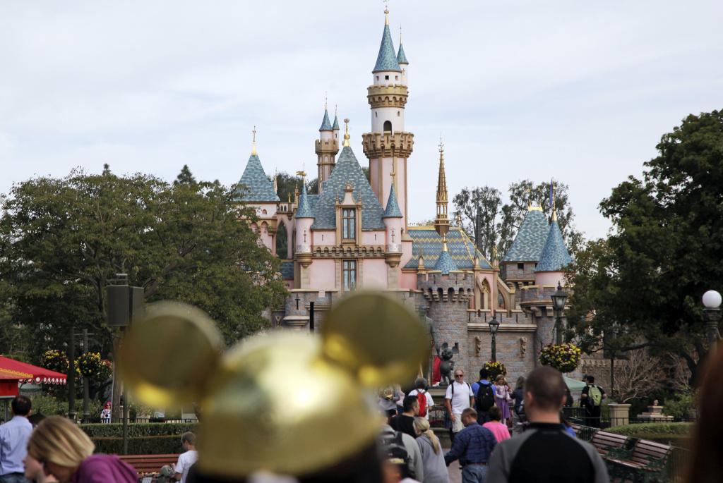 Visitors walk toward Sleeping Beauty's Castle at Disneyland in Anaheim, Calif.