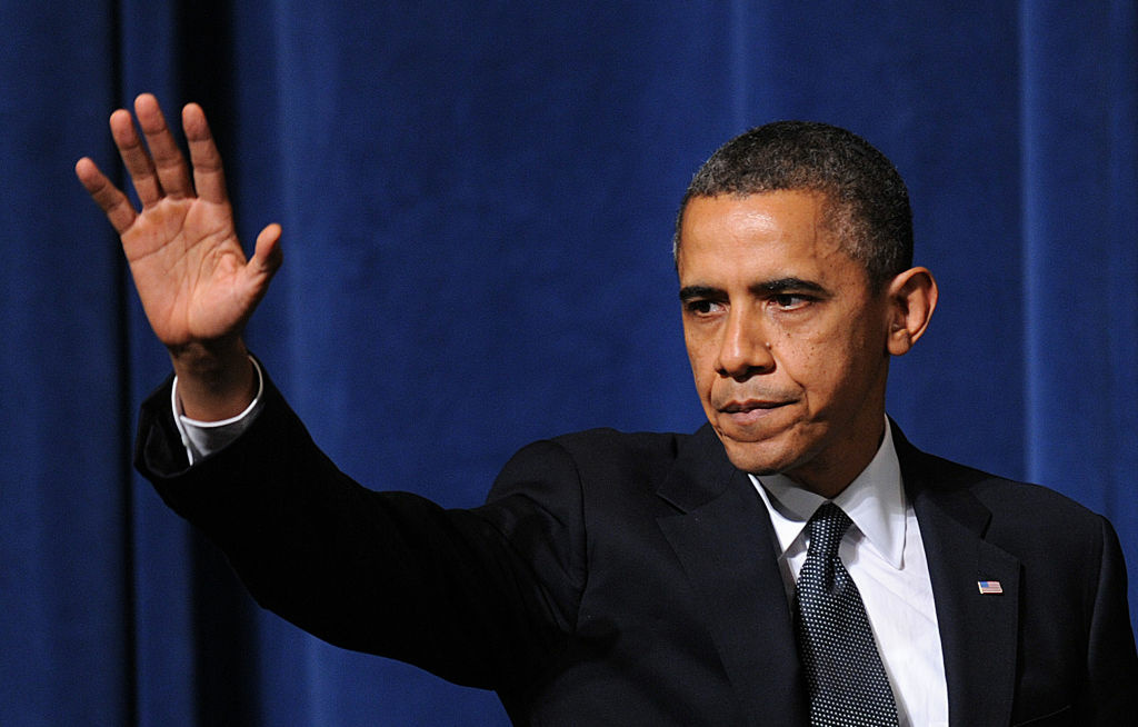 U.S. President Barack Obama waves after speaking at an interfaith vigil for the shooting victims from Sandy Hook Elementary School on December 16, 2012 at Newtown High School in Newtown, Connecticut.