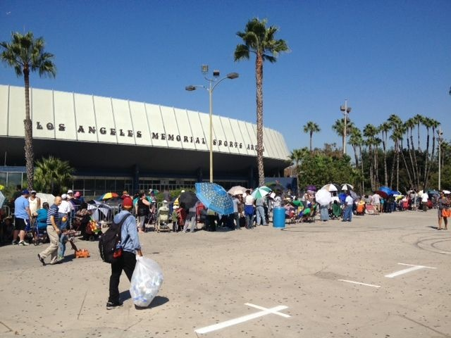 By late Monday morning, nearly 3,000 folks had lined up outside the L.A. Sports Arena to get an admission wristband for Thursday's free Care Harbor clinic.