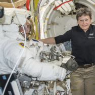 Astronaut Peggy Whitson became NASA's astronaut with the most time in orbit Monday. She's seen here earlier this year in the Quest airlock of the International Space Station with fellow astronauts aboard the International Space Station.