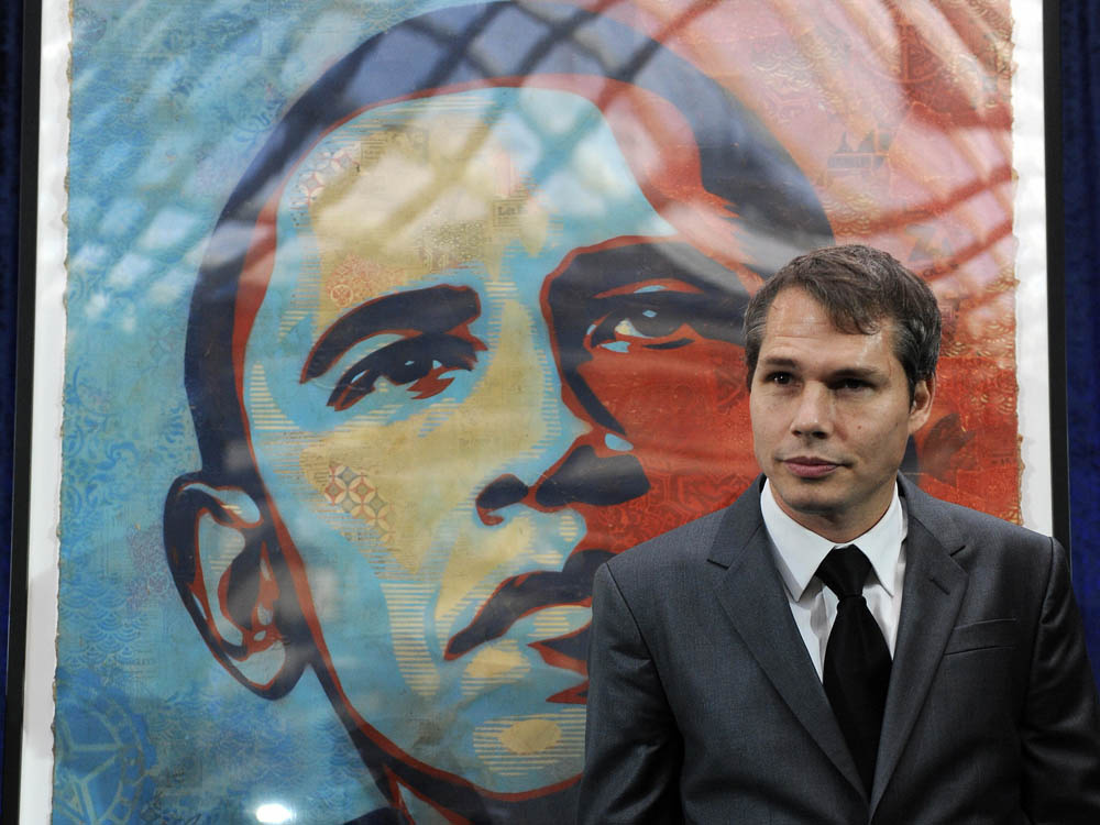 Shepard Fairey unveiling his portrait of then US president-elect Barack Obama before it was installed at the National Portrait Gallery in Washington, DC (2009)