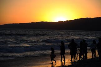 A family enjoys the beach near Los Angeles.