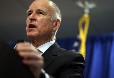 California Gov. Jerry Brown speaks during a news conference on January 17, 2014 in San Francisco, Calif. Brown will be in Mexico this week, with plans to discuss the border migrant crisis with religious leaders and to meet with Mexican president Enrique Peña Nieto.