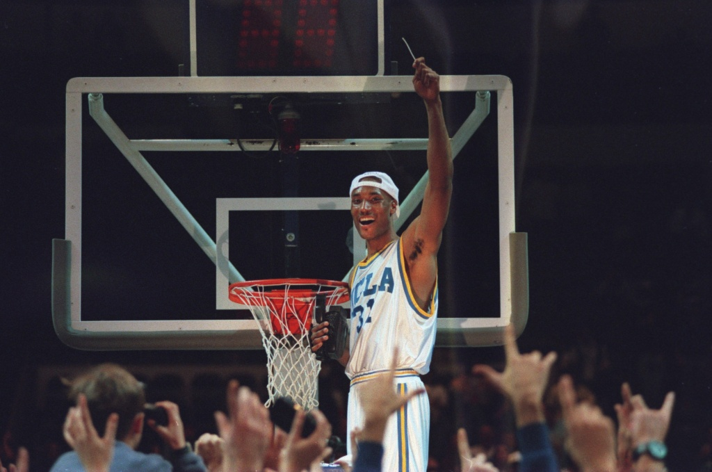 In this file photo, UCLA forward Ed O'Bannon celebrates by cutting his part of the net after the Bruins' 102-96 win over UConn in the NCAA West Regional Final at the Oakland Coliseum in Oakland, Calif., in March 1995. Some believe O'Bannon's legal crusade against the NCAA will upend the way college sports operate.