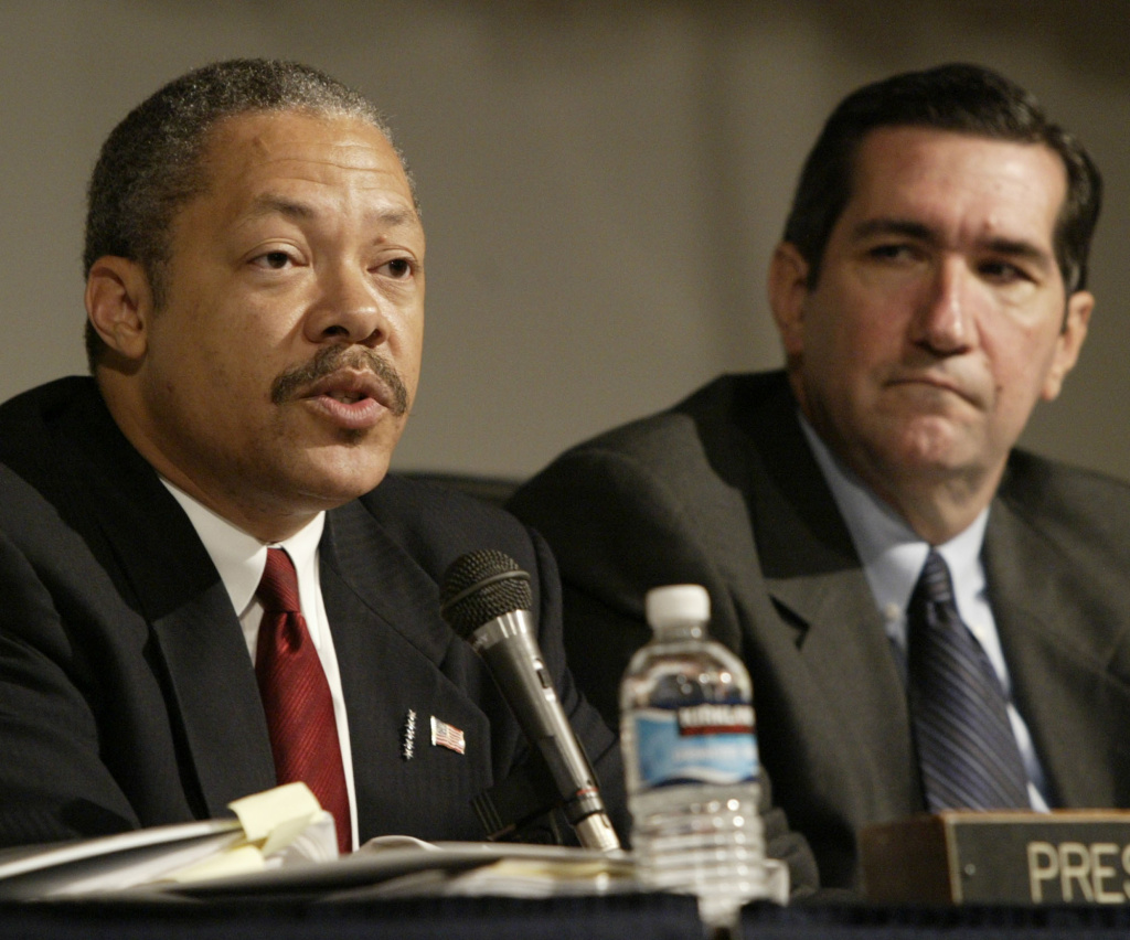 In this file photo, David Cunningham, left, then-president of the Board of Police Commissioners, and Alan Skobin, vice president of the board, speak during a meeting of the Board of Police Commissioners Tuesday, July 13, 2004, in Los Angeles. Cunningham has filed a $10 million claim against UCLA police alleging that officers racially profiled him and used excessive force in a traffic stop that began over not wearing his seat belt.