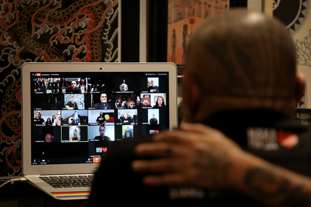 Ethan Thompson and partner Jurrah Chilcott look on during the Haka and Corroboree for Life ANZAC online service via Zoom on April 25, 2020 in Sydney, Australia.