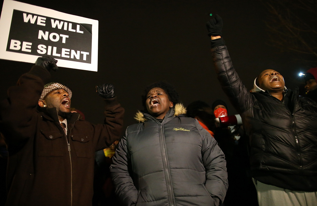 FERGUSON, MO - NOVEMBER 24:  Demonstrators block traffic as they protest in front of the Ferguson police department on November 24, 2014 in Ferguson, Missouri. A St. Louis County grand jury has decided to not indict Ferguson police Officer Darren Wilson in the shooting of Michael Brown that sparked riots in Ferguson, Missouri in August.  (Photo by Justin Sullivan/Getty Images)
