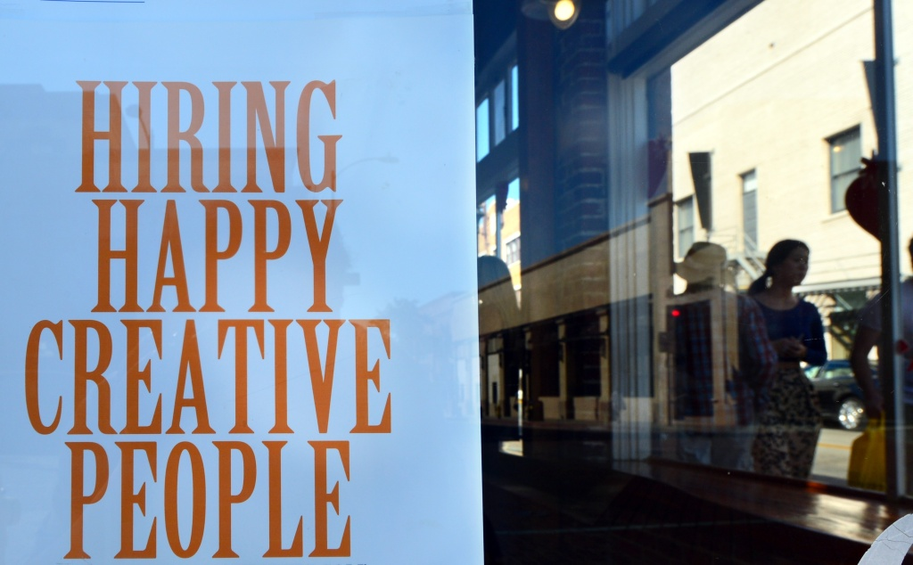 A sign posted on a shopfront window offers employment opportunity to happy and creative people on October 22, 2013 in Pasadena, California. This month's political showdown likely shaved at least a quarter percent off fourth quarter economic growth and meant 120,000 fewer jobs were created in October, the White House said today. The US economy generated a less-than-expected 148,000 jobs during the last month, but revisions for July and August that added 9,000 net new positions to the data helped push the overall unemployment rate down.