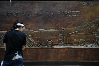 A woman looks at a memorial to firefighters who perished during the 9/11 World Trade Center attacks at Ground Zero, in New York, on September 7, 2011.