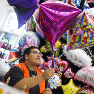 Karina Gutierrez, 17, is a senior at John Marshall High School and part of the Regional Occupational Program. Gutierrez works the balloon station at Party City in Los Angeles' Atwater Village.