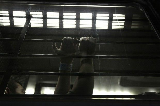 A detainee waits to be processed at an immigrant detention facility Arizona. Photo by John Moore/Getty Images