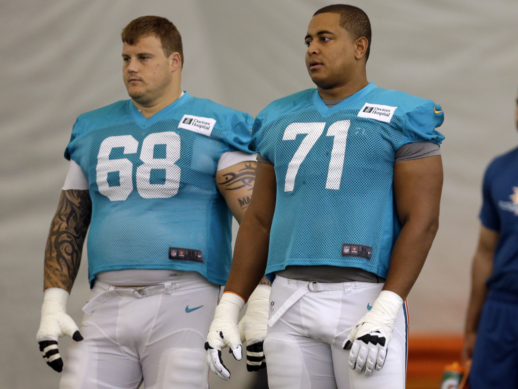 Miami Dolphins offensive Richie Incognito, left, and Jonathan Martin in July.