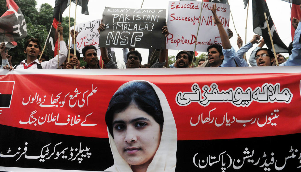 Pakistani youths shouts slogans during a protest against the assassination attempt by Taliban on child activist Malala Yousafzai in Lahore on October 15, 2012. A teenage Pakistani rights activist was flown to Britain for specialist long-term care on October 15 after being shot in the head by the Taliban for campaigning for the right to education. Malala Yousafzai, 14, who was attacked on her school bus in the former Taliban stronghold of the Swat valley last Tuesday, was sent abroad at a time when her condition is 'optimal and before any unforeseen complications set in', the military said.
