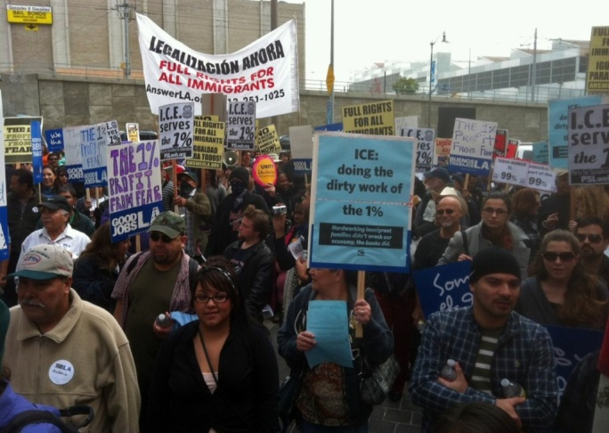 Hundreds protest against immigration policies at the downtown L.A. federal building.