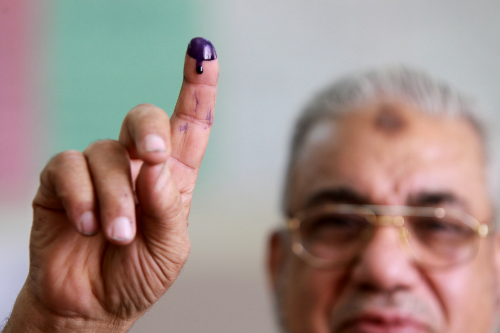 An Egyptian man shows his ink-stained fi