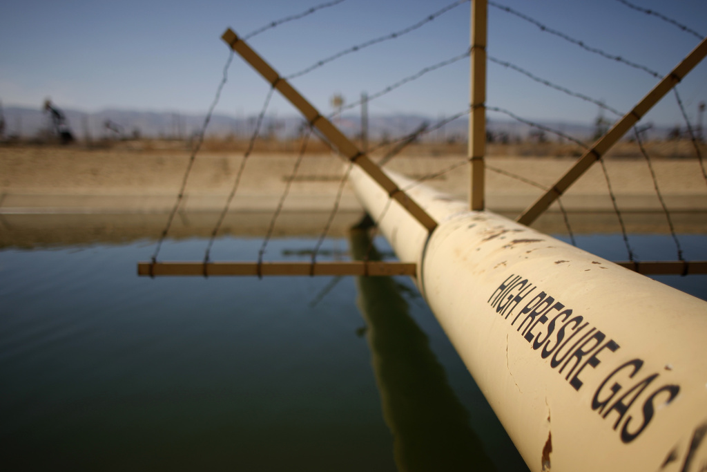 A high pressure gas line crosses over a canal in an oil field over the Monterey Shale formation where gas and oil extraction using hydraulic fracturing, or fracking, is on the verge of a boom on March 23, 2014 near Lost Hills, California.