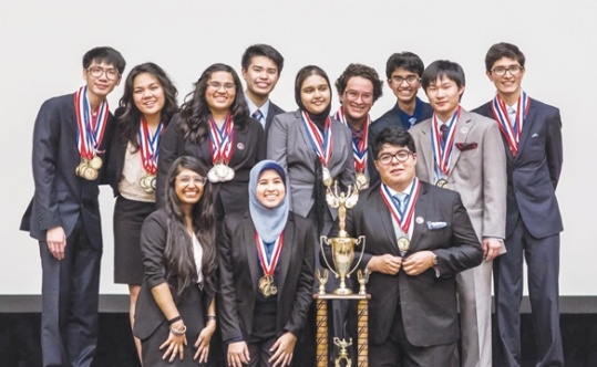 Members of the 2016 Granada Hills Charter High School Academic Decathlon team with their trophy for winning the Los Angeles Unified School District competition in February 2016.