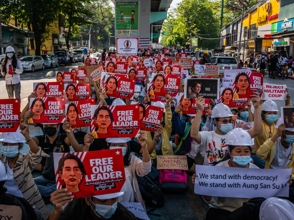 Protesters hold images of de-facto leader Aung San Suu Kyi on Wednesday in Yangon, Myanmar. As fallout from the Feb. 1 military coup continues, U.S. President Joe Biden announced plans to sanction the leaders who directed it.
