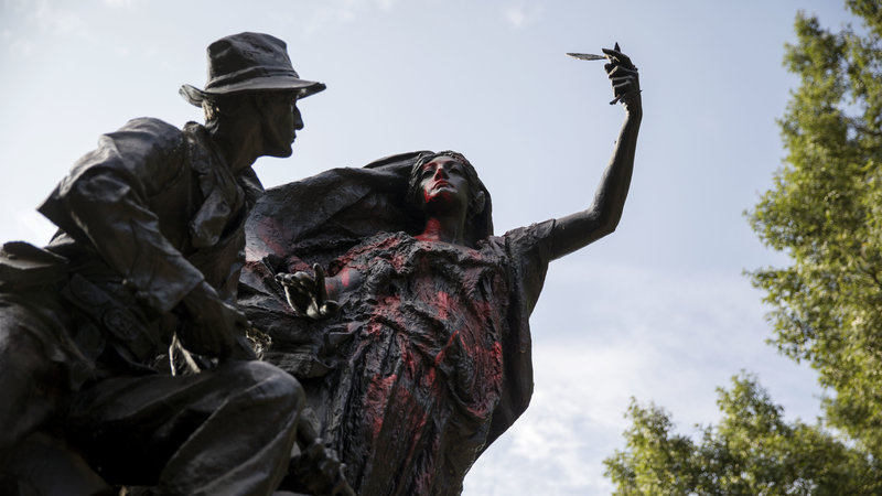 A statue of a Confederate soldier in Atlanta's Piedmont Park stands vandalized with spray paint on Monday. It was not the only Confederate monument to be vandalized in the wake of the violence in Charlottesville a statue in Louisville Ky. was splattere