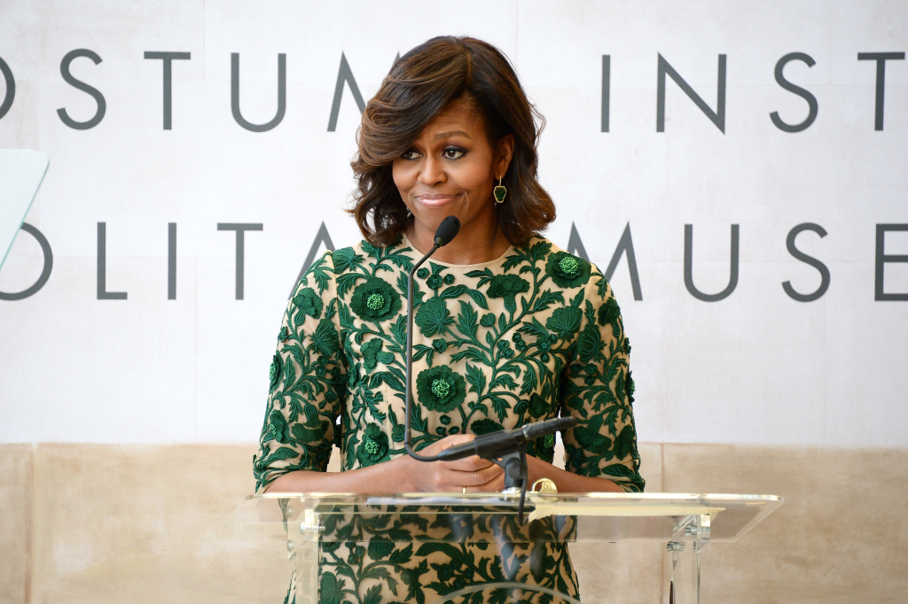In this file photo, First Lady of the United States Michelle Obama speaks onstage at the Anna Wintour Costume Center Grand Opening at the Metropolitan Museum of Art on May 5, 2014 in New York City. Obama is visiting Los Angeles Wednesday to deliver a pair of speeches.
