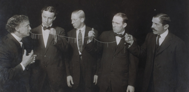 Houdini (L) performs his famous needle and thread trick.