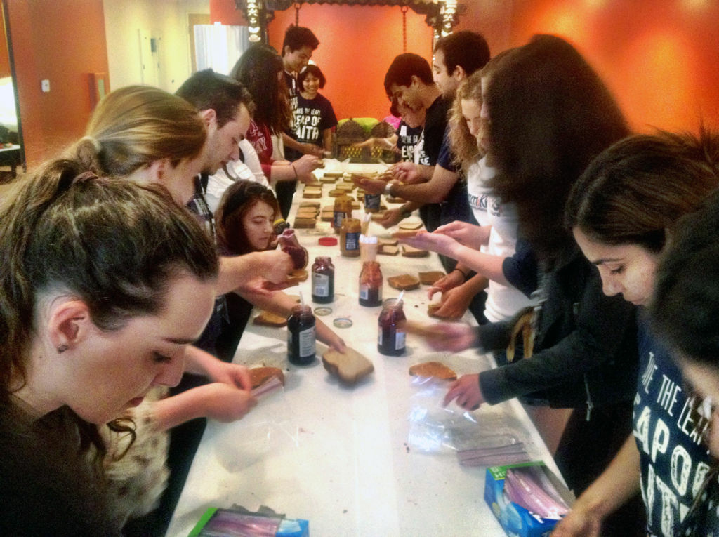 UCI students at the Center for Living Peace in Irvine making sandwiches for homeless people in Orange County.
