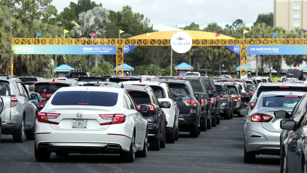 Cars line up to enter SeaWorld as it reopens, on June 11, in Orlando, Fla. The park had been closed since mid-March to stop the spread of the coronavirus.