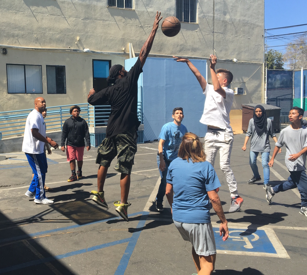 Students at City High School, a now-shuttered charter school in the Pico-Robertson neighborhood of Los Angeles, play basketball against their teachers during one of the school's final days in operation.