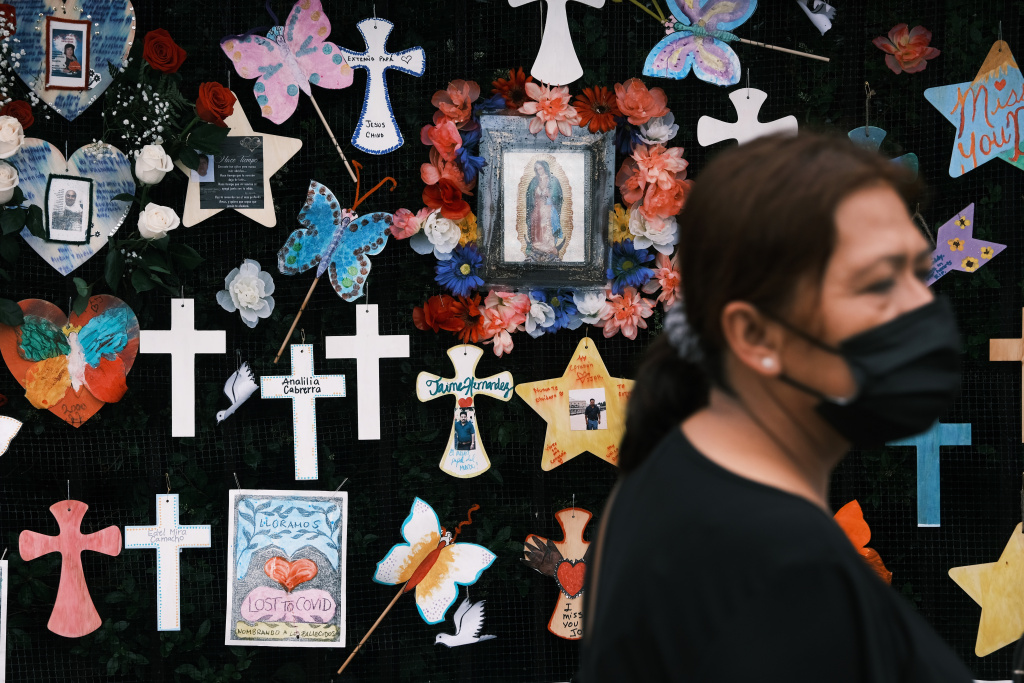 Memorials hang from the front gate of Greenwood Cemetery during an event and procession organized by Naming the Lost Memorials to remember and celebrate the lives of those killed by the Covid-19 pandemic on June 08, 2021 in New York City.