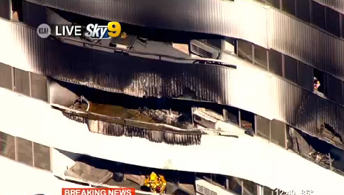 "This video image provided by KCAL-TV shows a fire-damaged high rise apartment building Friday Oct. 18, 2013 in Los Angeles. Firefighters said three people have been taken to hospitals and ""a handful"" of others are being assessed for non-life threatening injuries."