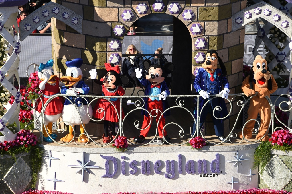 Disney characters wave from Disneyland Resort's Diamond Celebration float celebrating the park's 60th anniversary, in the 127th Rose Parade in Pasadena on Jan. 1, 2016.
