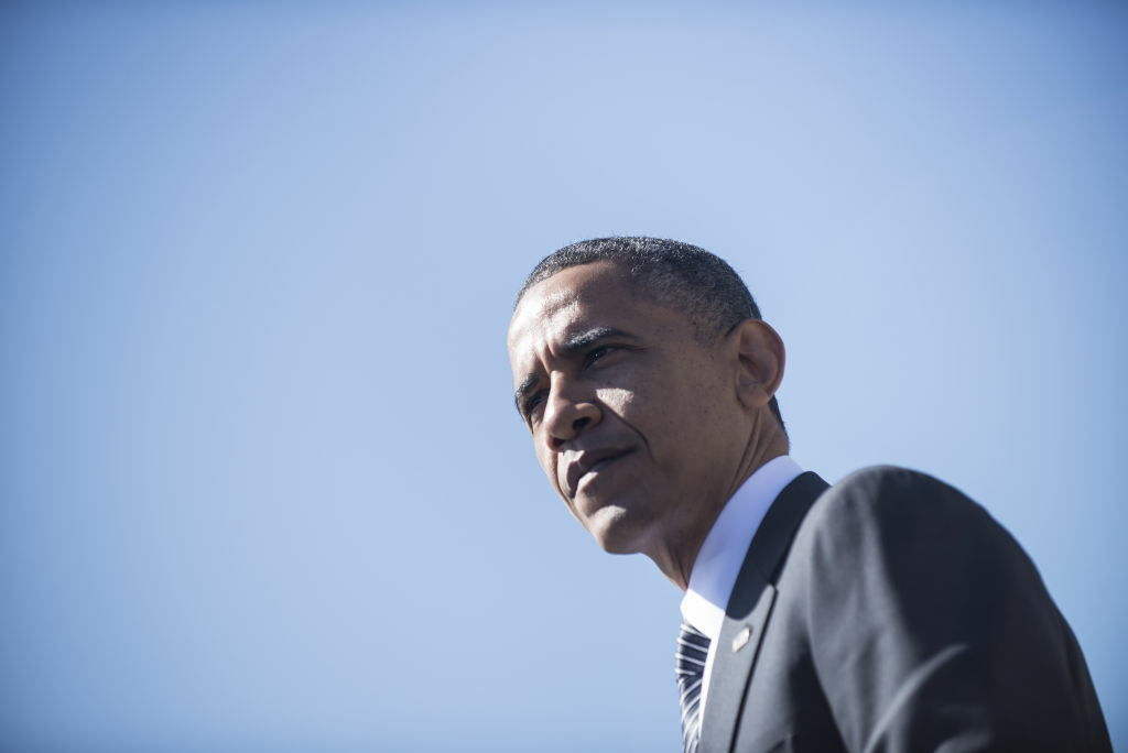 US President Barack Obama pauses while speaking at the establishment of the Chavez National Monument October 8, 2012 in Keene, California. Obama is on a three day trip where he will campaign in California and Ohio as well as attend the establishment of the Cesar E. Chavez National Monument.
